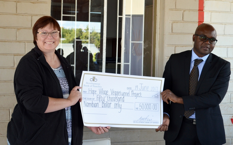 DBN has great expectations for Hope Village. DBN CEO Martin Inkumbi, pictured with Hope Village Director Marietjie de Klerk, recently donated N$50,000 to Hope Village for construction of Veggietunnels which will grow food for the orphans and vulnerable children of the center, and the surrounding community.