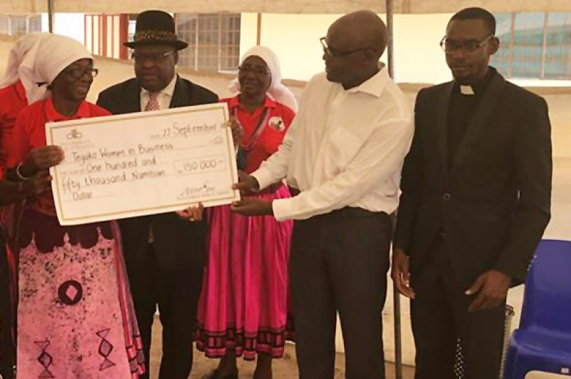 A dam for community development. Development Bank of Namibia CEO Martin Inkumbi recently handed over N$150,000 for construction of a dam to the Tegako 2020 Women in Business Co-operative, represented by Mrs. Teopolina Tegelela Negonga. The dam, at Olulongo in the Oshana Region will be used for Tilapia farming, and to irrigate crops. In the background, Tatekulu Herman Ndilimani Iipumbu, Chief of the Uukwambi Traditional Authority looks on. Rev. Nghilalulwa Wilhem is seen at the right.